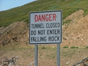 needle_eye_tunnel_warning_sign