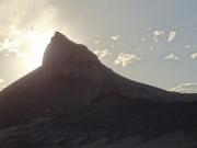 sun_behind_a_peak