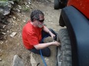 gary_fixing_monicas_tire_part_2